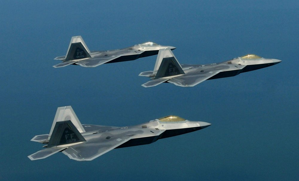 F-22 Raptors fly in formation. The Air Force's first four pilots to go directly to the F-22 without previous fighter experience are currently training at Luke Air Force Base, Ariz., in preparation for taking on the F-22. (U.S. Air Force photo/Staff Sgt. Samuel Rogers)