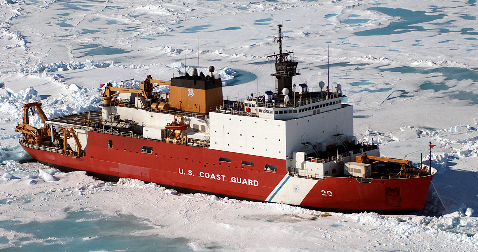 The U.S. Coast Guard Healy Class Icebreaker HEALY (WAGB 20) sits in the ice, about 100 miles north of Barrow, Alaska, in order to allow scientists onboard to take core samples from the floor of the Arctic Ocean on June 18, 2005. (U.S. Coast Guard photo by Public Affairs Specialist 2nd Class NyxoLyno Cangemi) (Released)