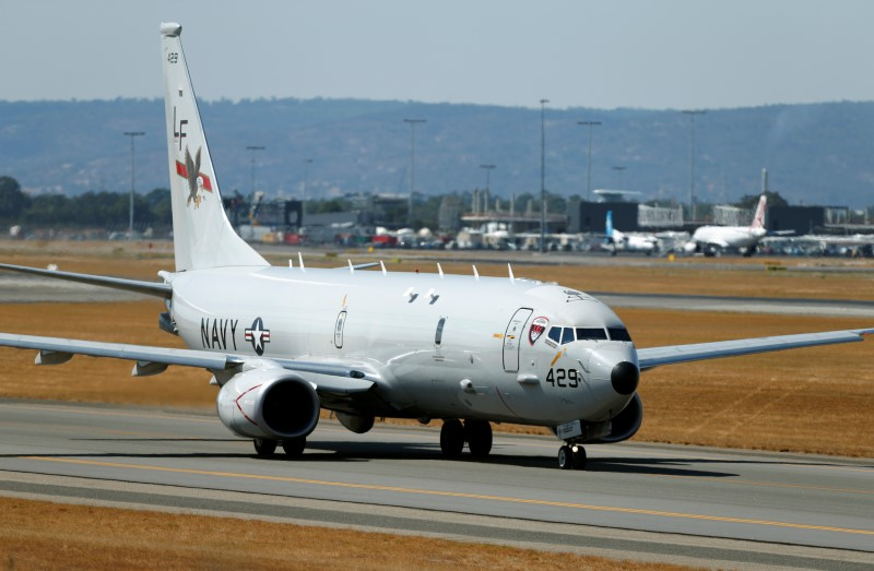 A U.S. Navy Poseidon P8 maritime surveillance aircraft taxis before taking off at Perth International Airport, March 28, 2014. REUTERS/Jason Reed